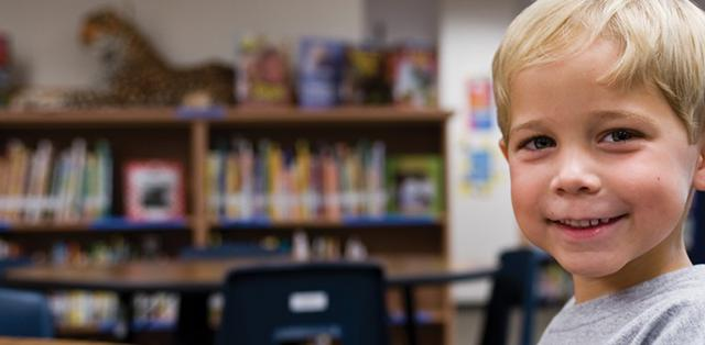 Boy in classroom smiling